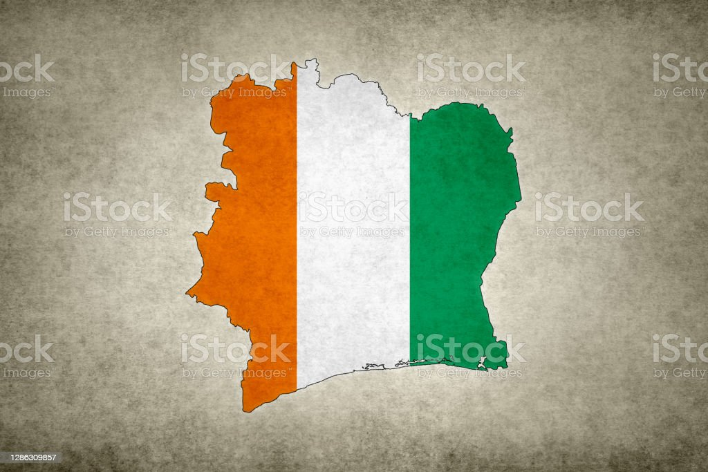 Grunge map of Ivory Coast with its flag printed within Grunge map of Ivory Coast with its flag printed within its border on an old paper. Abstract Stock Photo