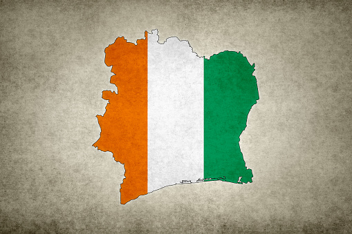 Grunge Map Of Ivory Coast With Its Flag Printed Within Stock Photo - Download Image Now