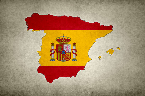 Grunge map of Spain with its flag printed within stock photo