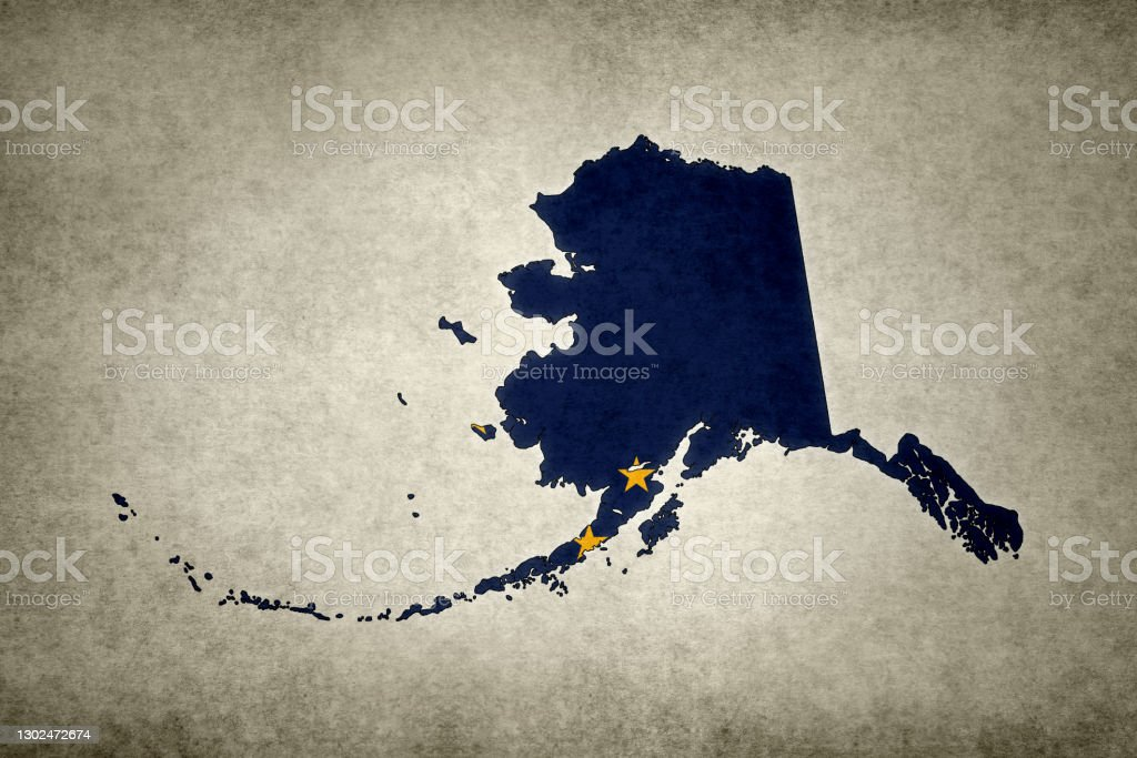 Grunge map of the state of Alaska with its flag printed within Grunge map of the state of Alaska (USA) with its flag printed within its border on an old paper. Abstract Stock Photo