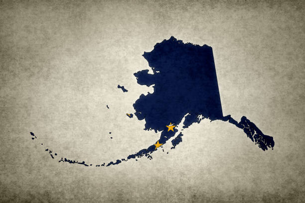 Grunge map of the state of Alaska with its flag printed within stock photo