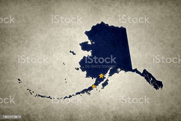 Grunge Map Of The State Of Alaska With Its Flag Printed Within Stock Photo - Download Image Now