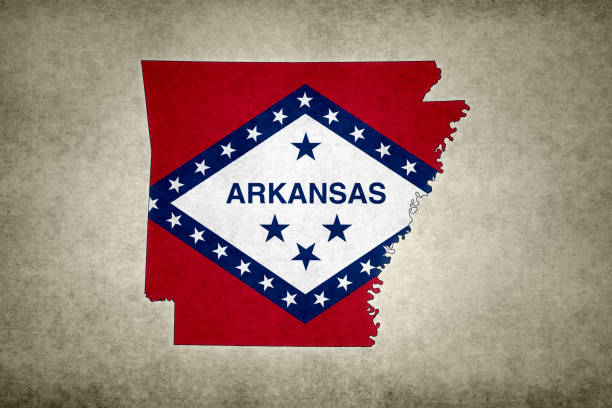 Grunge map of the state of Arkansas with its flag printed within stock photo