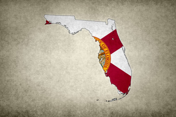 Grunge map of the state of Florida with its flag printed within stock photo