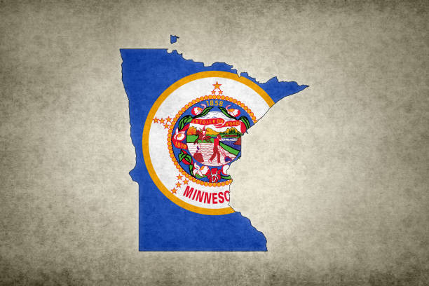 Grunge map of the state of Minnesota with its flag printed within stock photo