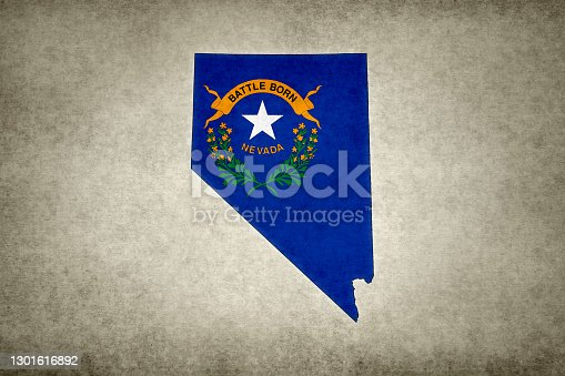 Grunge map of the state of Nevada (USA) with its flag printed within its border on an old paper.