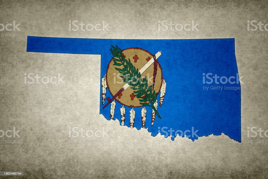 Grunge map of the state of Oklahoma with its flag printed within Grunge map of the state of Oklahoma (USA) with its flag printed within its border on an old paper. Abstract Stock Photo