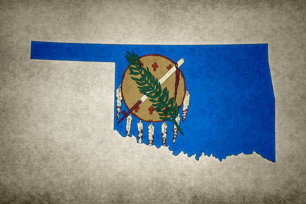 Grunge map of the state of Oklahoma with its flag printed within stock photo