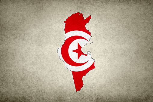 Grunge map of Tunisia with its flag printed within its border on an old paper.