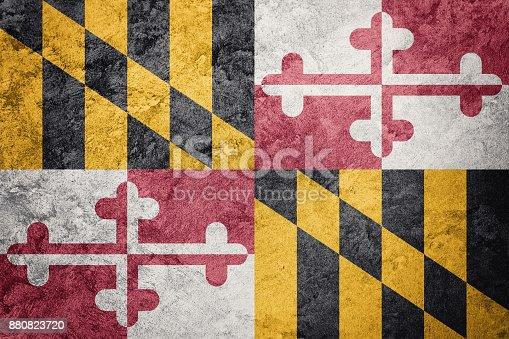 istock Grunge Maryland state flag. Maryland flag background grunge texture. 880823720