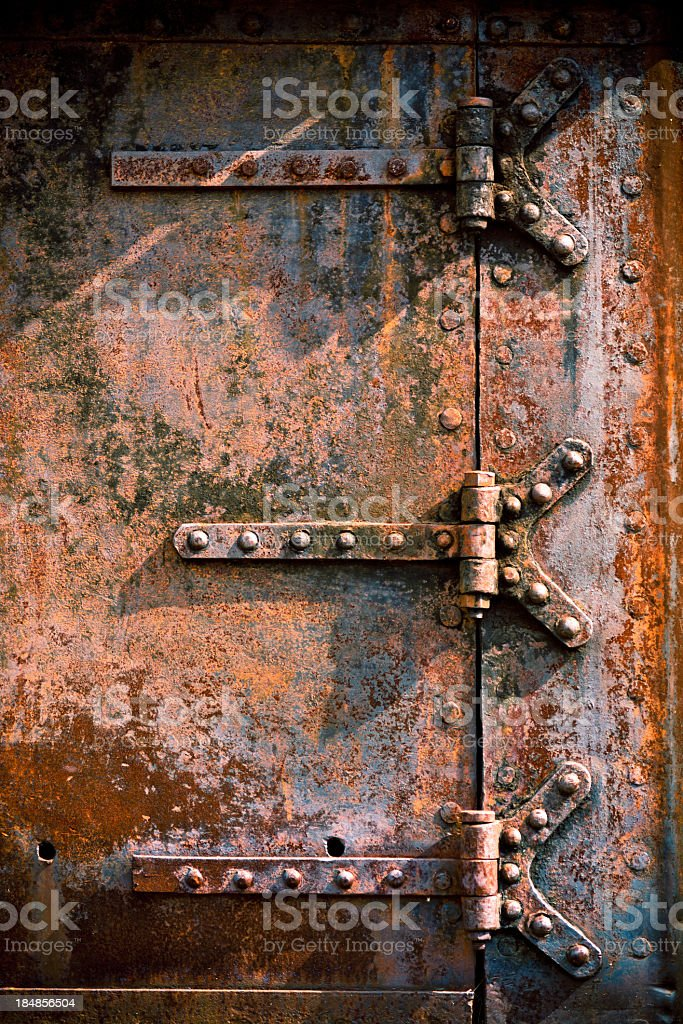 Grunge Metal Door with rusty hinge royalty-free stock photo