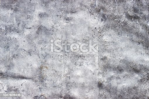 938345942 istock photo Grunge metal pattern, dirty aluminum texture with dents and scratches as background 1047628436