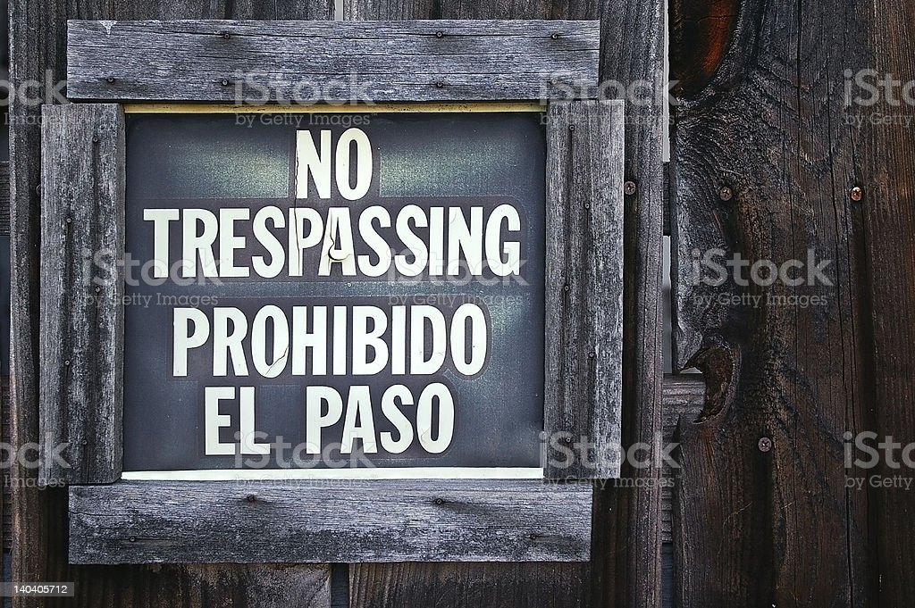 Grunge 'NO TRESPASSING' sign royalty-free stock photo