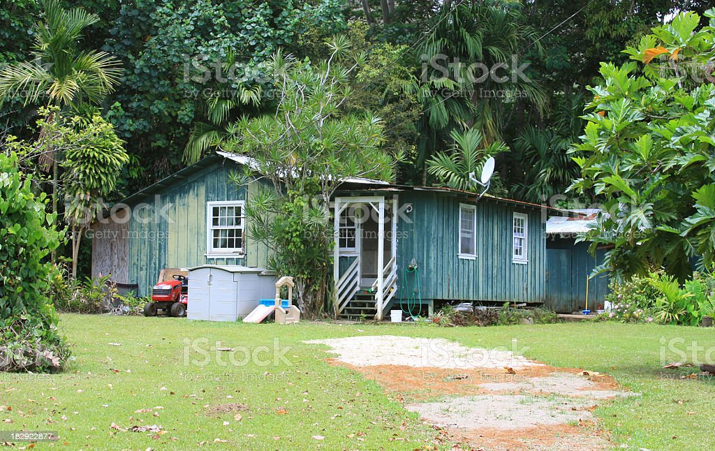 Grunge old cottage home on Kauai, Hawaii stock photo