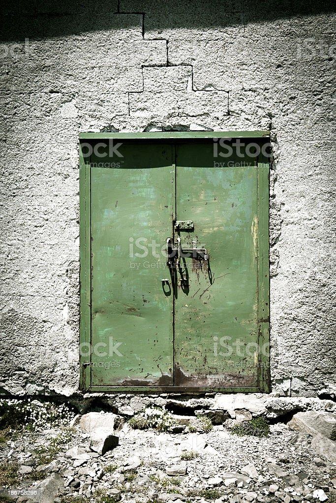 Grunge Old Iron Green Door royalty-free stock photo