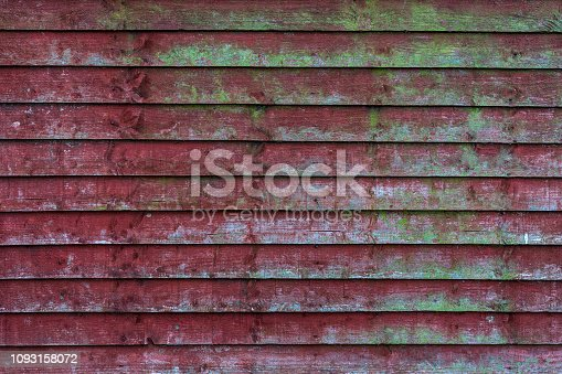 istock Grunge old red wooden fence with green mos patterns - high quality texture / background 1093158072