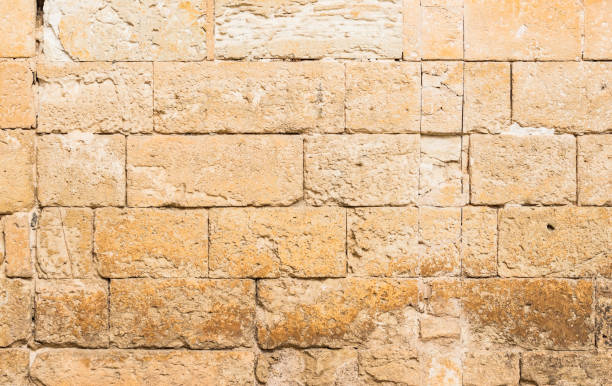 Grunge old stone wall texture Vintage grunge stone wall background texture, close-up antediluvian stock pictures, royalty-free photos & images