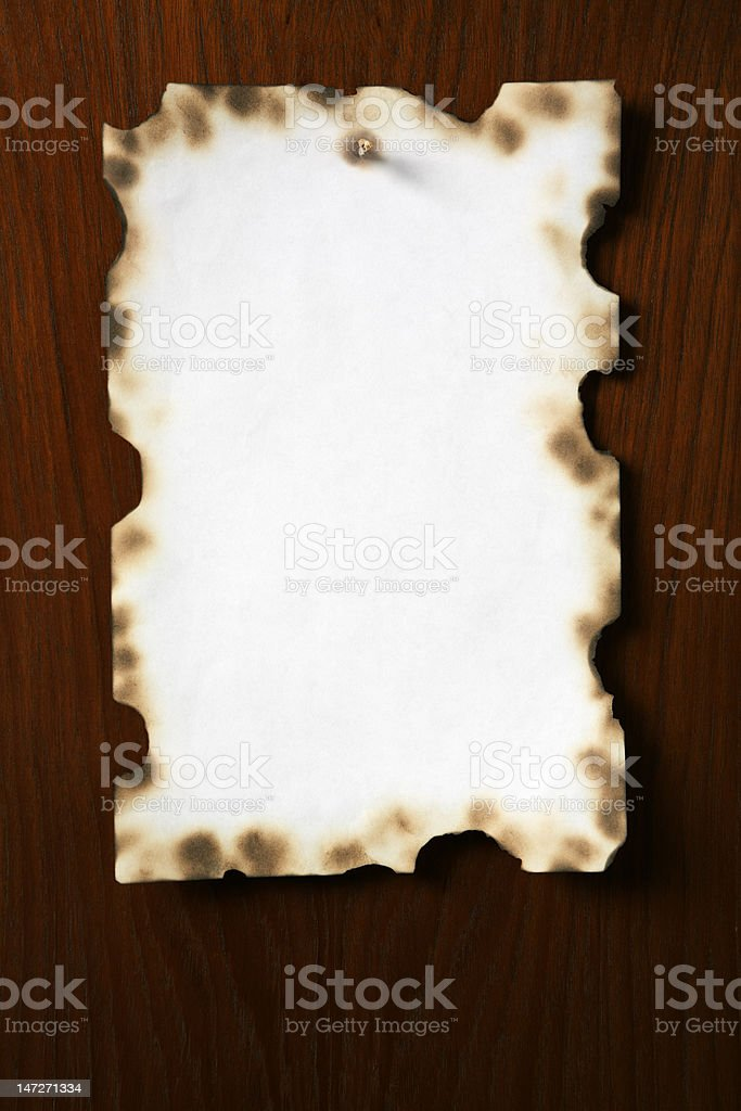Grunge paper on wooden board royalty-free stock photo