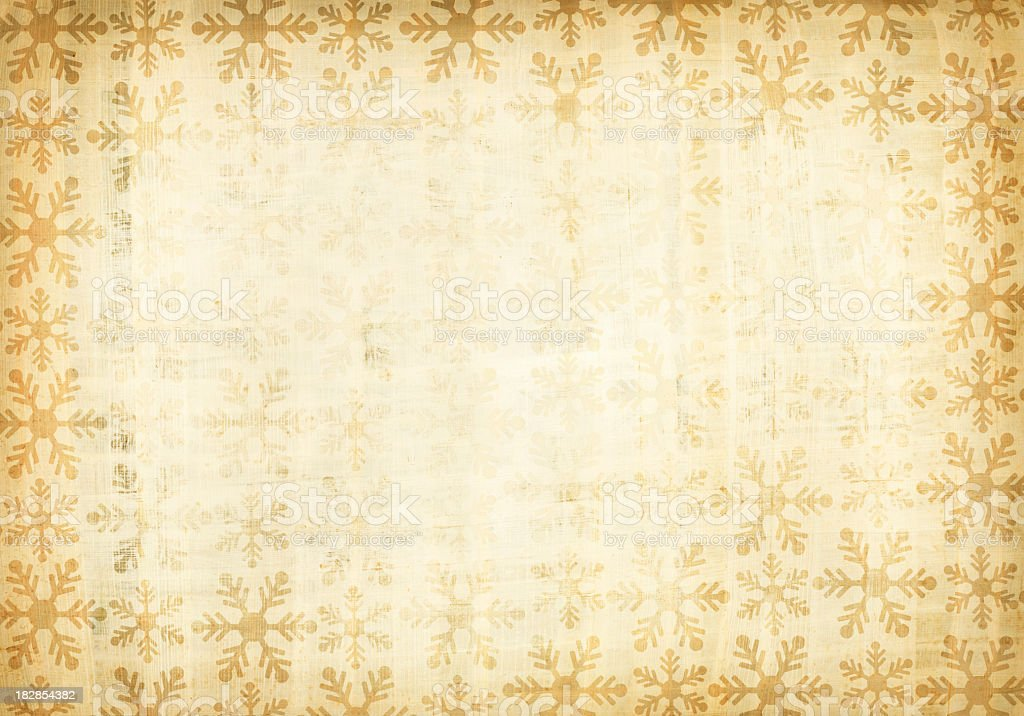 A grunge paper with patterns of snow flakes royalty-free stock photo