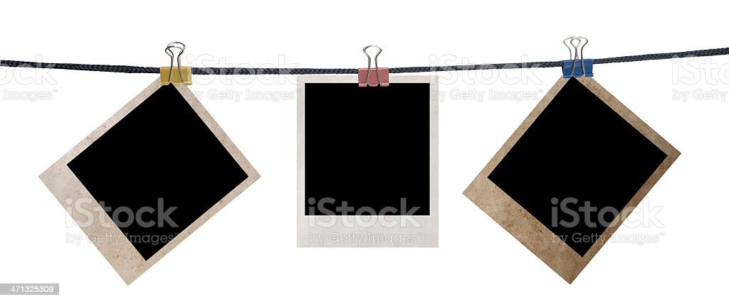 grunge photo frames on a rope royalty-free stock photo