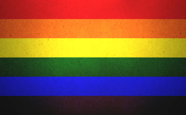 Grunge Rainbow flag printed on a paper stock photo
