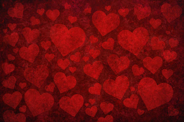 Grunge red background with heart shapes stock photo