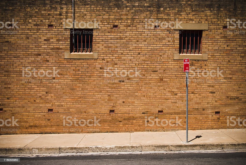 Grunge red brick wall and sign in urban back street royalty-free stock photo