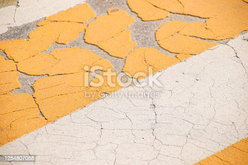 Grunge Road Markings For Pedestrians Waith Yellow And White Paints texture.