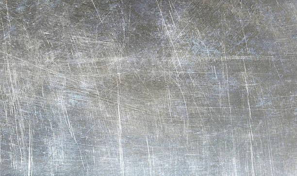 Grunge shiny metallic texture stock photo