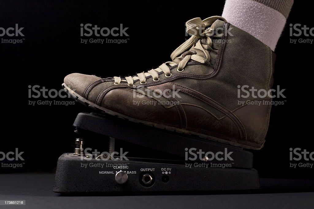 grunge shoe on a whammy pedal royalty-free stock photo