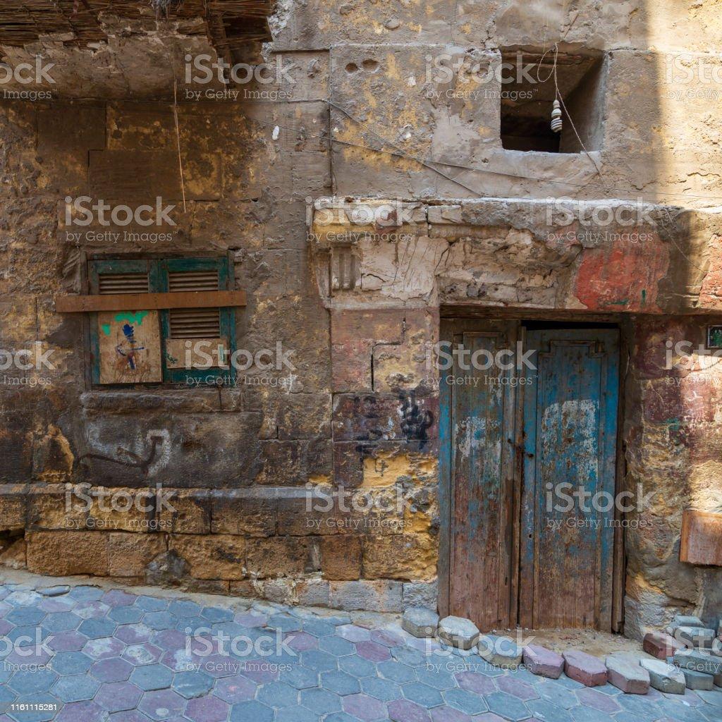 Grunge stone bricks wall with Broken wooden door and closed broken...