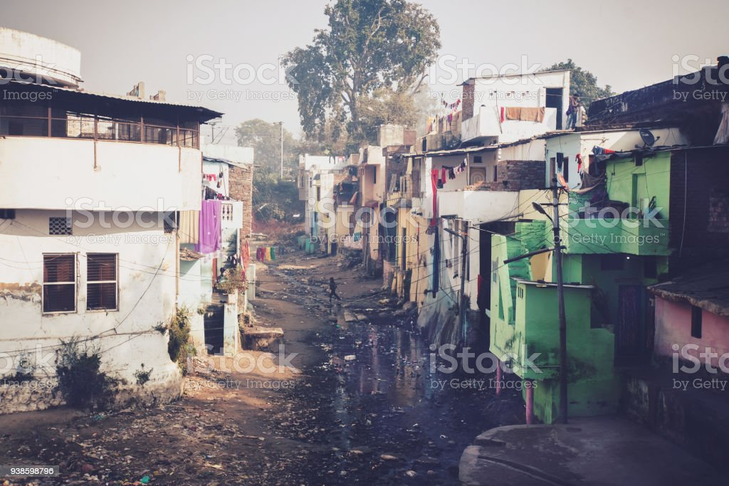 Grunge stone houses in poor area of historical indian town. stock photo
