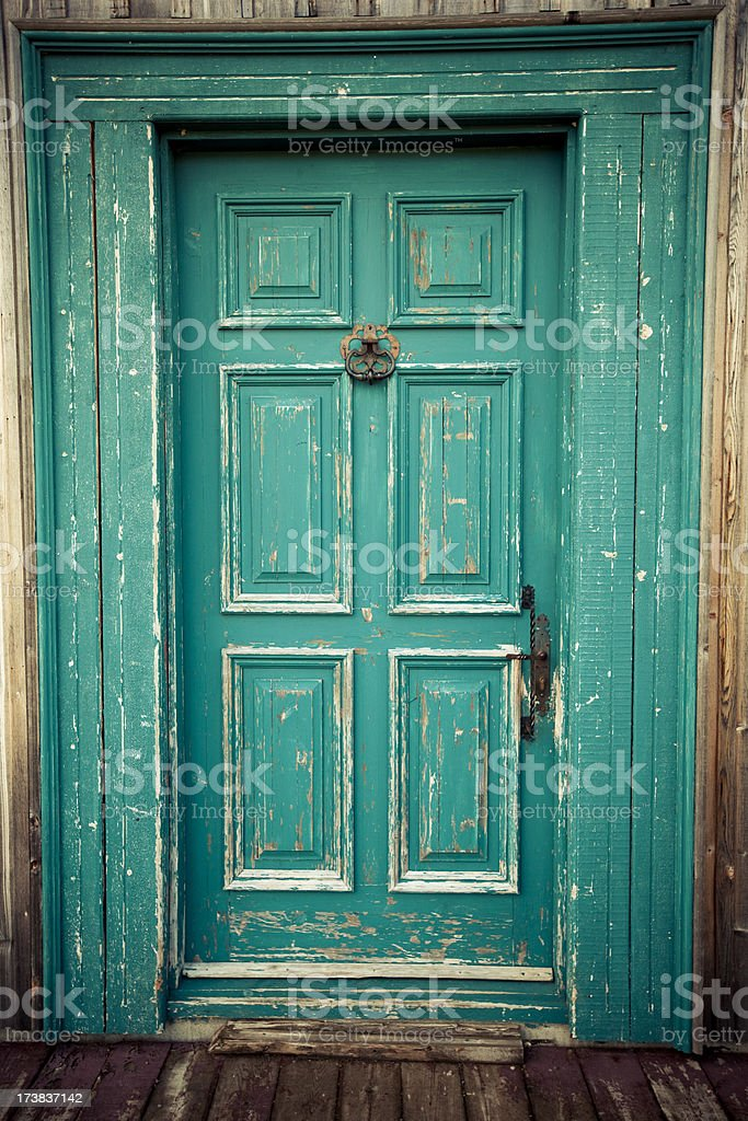 Grunge style blue front door made of wood royalty-free stock photo
