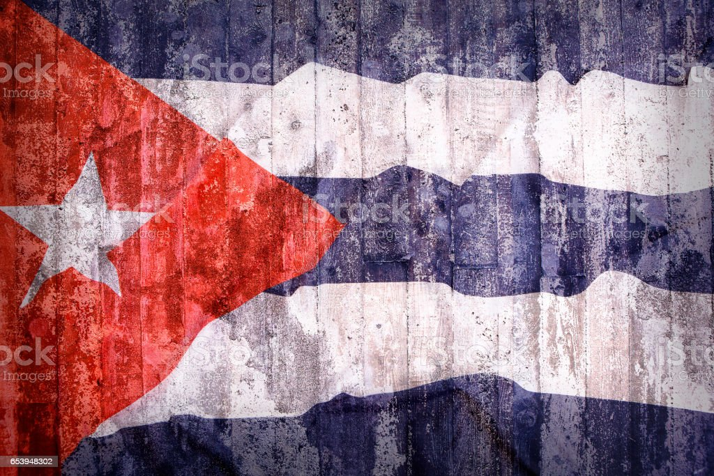 Grunge style of Cuba flag on a brick wall stock photo