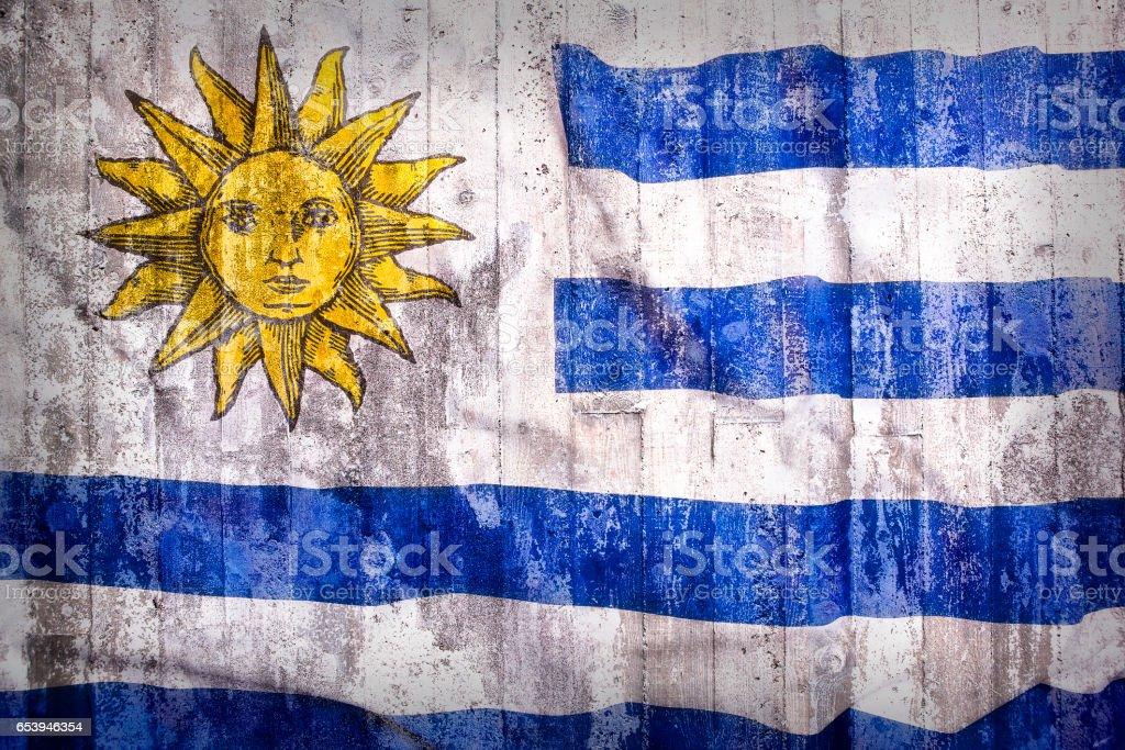 Estilo grunge de la bandera de Uruguay en una pared de ladrillo - foto de stock