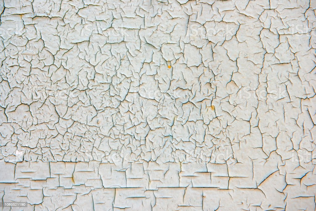 Grunge surface with cracked paint stock photo