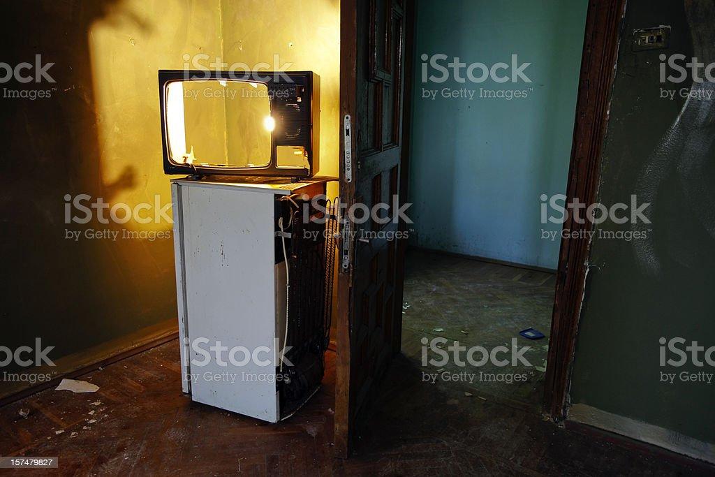 Grunge Television (TV) on old fridge royalty-free stock photo