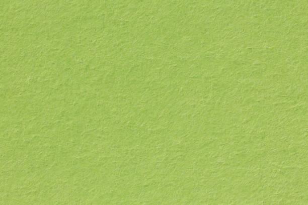 grunge texturerade färgade retro grön returpapper bakgrund - dirty money bildbanksfoton och bilder