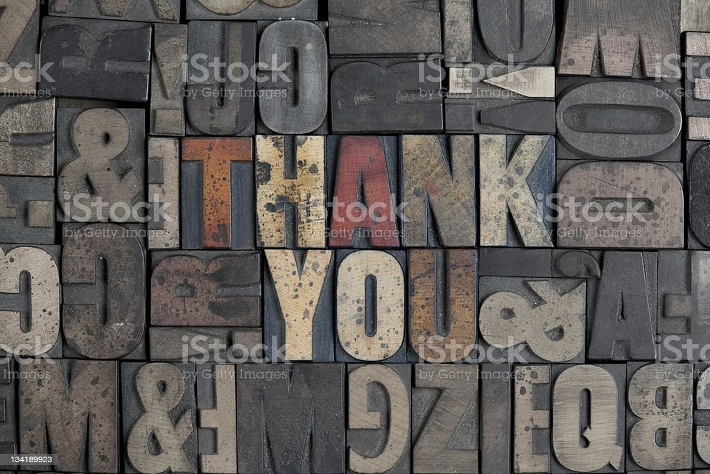 Grunge thank you sign in typefaces with metal royalty-free stock photo