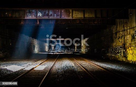 Grunge Train Tunnel with light beams, graffiti and dark overtones