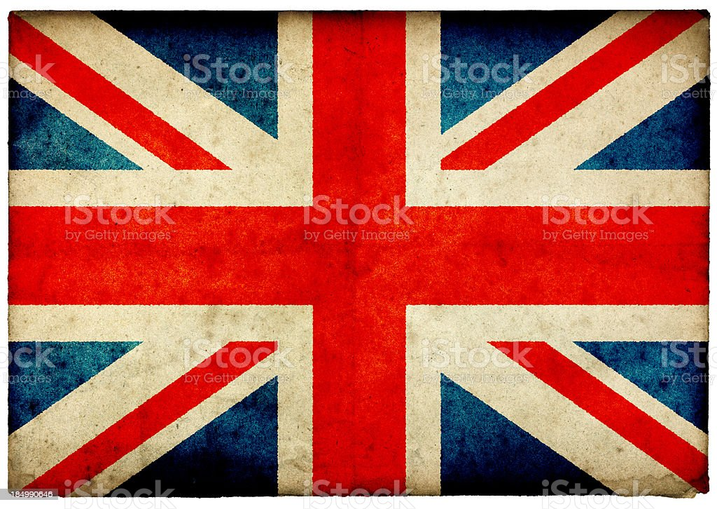 Grunge Union Jack Flag on rough edged old postcard stock photo