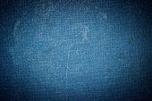 istock Grunge vignetted textile background - dark blue colored 492157320