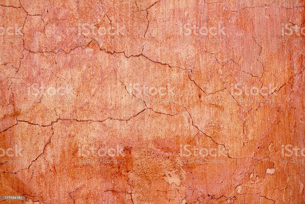 grunge wall cracked texture in orange stock photo