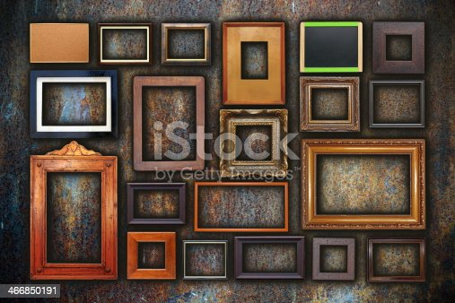 istock grunge wall full of old frames 466850191