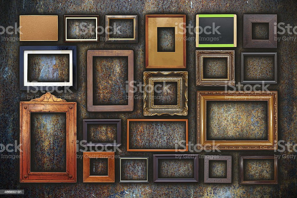 grunge wall full of old frames stock photo