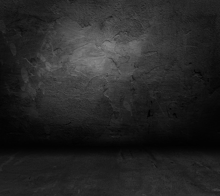 Background. Grunge wall in dark abandoned room.