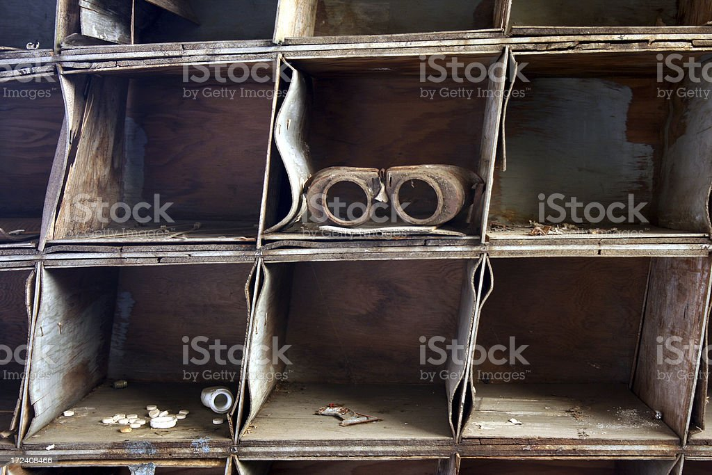 Grunge warped water damaged wooden shelves with goggles royalty-free stock photo