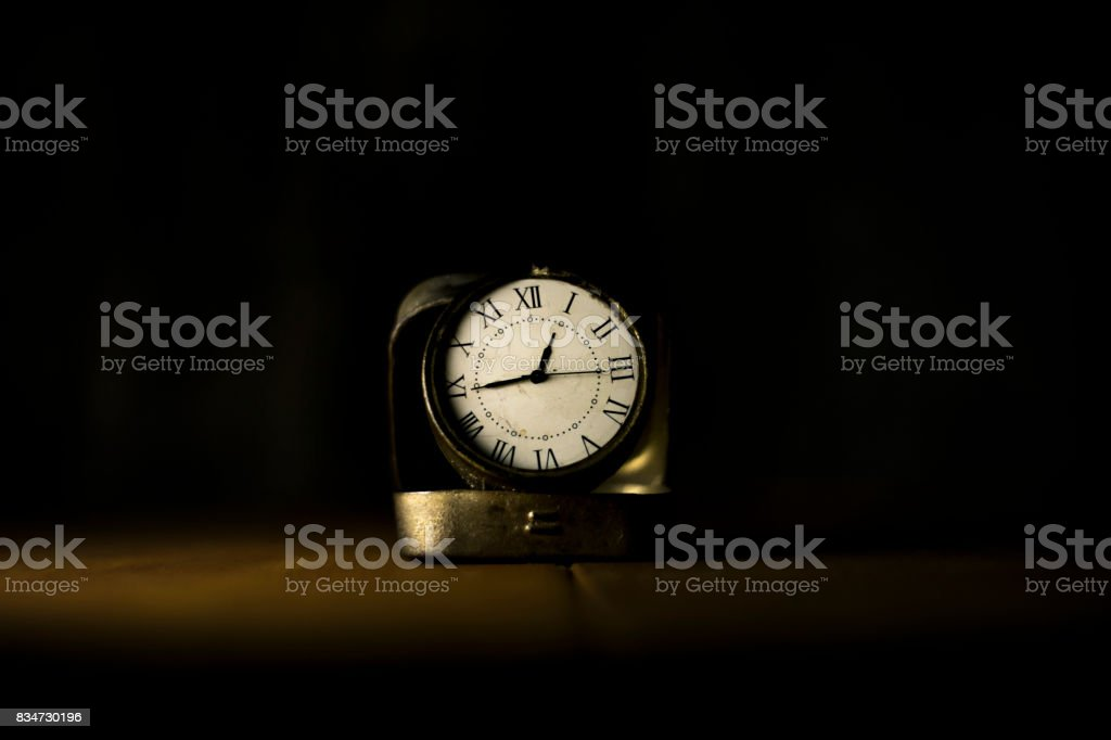 Grunge Watch on Wooden table stock photo