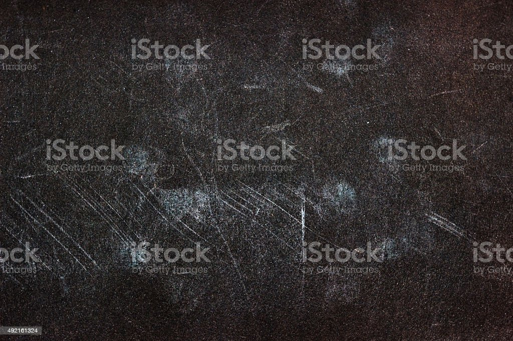 Grunge weathered old paper background - dark brown colored stock photo