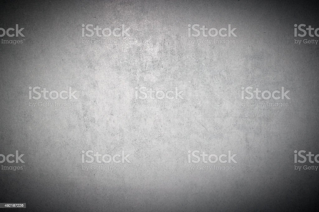 Grunge weathered old paper background - gray colored and vignetted stock photo